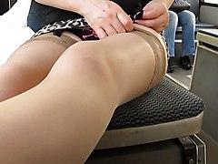 Girl Flashing Tan Stockings And Skull Panties In Bus