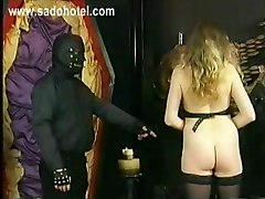 Horny Slave With Beautiful Big Tits And Tight Pussy Is Stuck In Masked Master His Dungeon And Hit On Her Ass