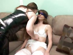 Black Leather Mistress Punishes Her White Stockings Slave
